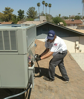 Sun City Mechanical Technician Working on System